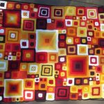Покрывало крючком из разноцветных квадратиков разных размеров