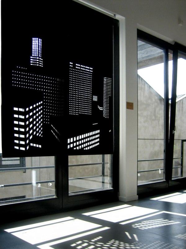 Рулонные шторы с перфорацией на офисных окнах