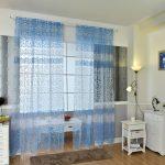 Голубые занавески с красивой вышивкой