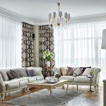 Интерьер угловой гостиной с двумя диванами