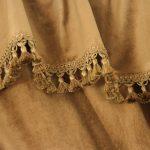 Коричневая ткань с декоративной бахромой