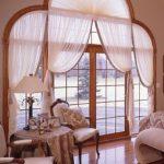Нестандартные шторы на панорамные окна в гостиной