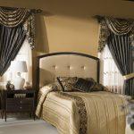 Темные симметричные ламбрекены для спальни с двумя окнами