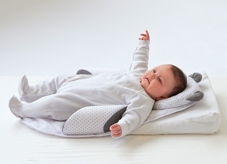 подушка для новорожденного ребенка