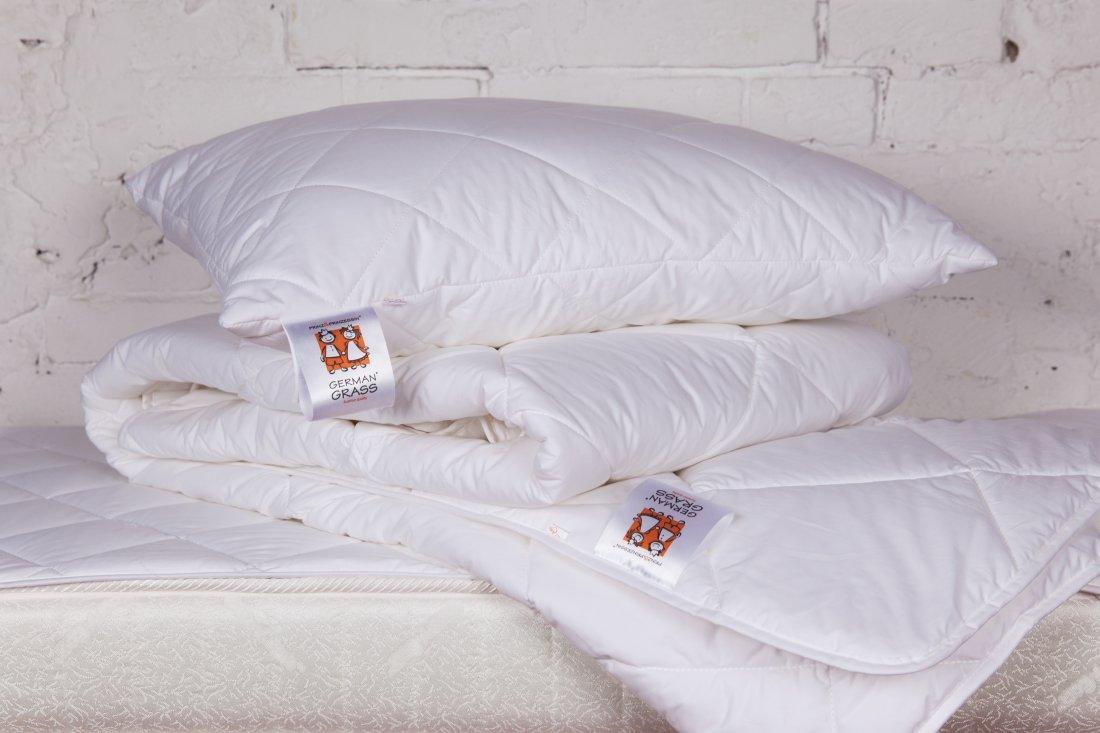 подушки и одеяло из лебяжьего пуха