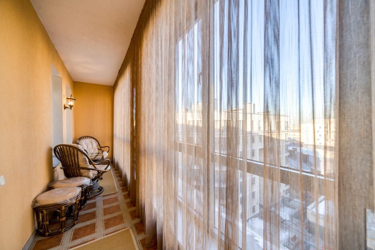 шторы на балкон идеи оформления