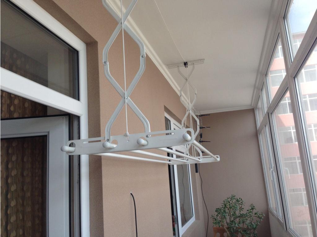 сушилка для белья на балконе
