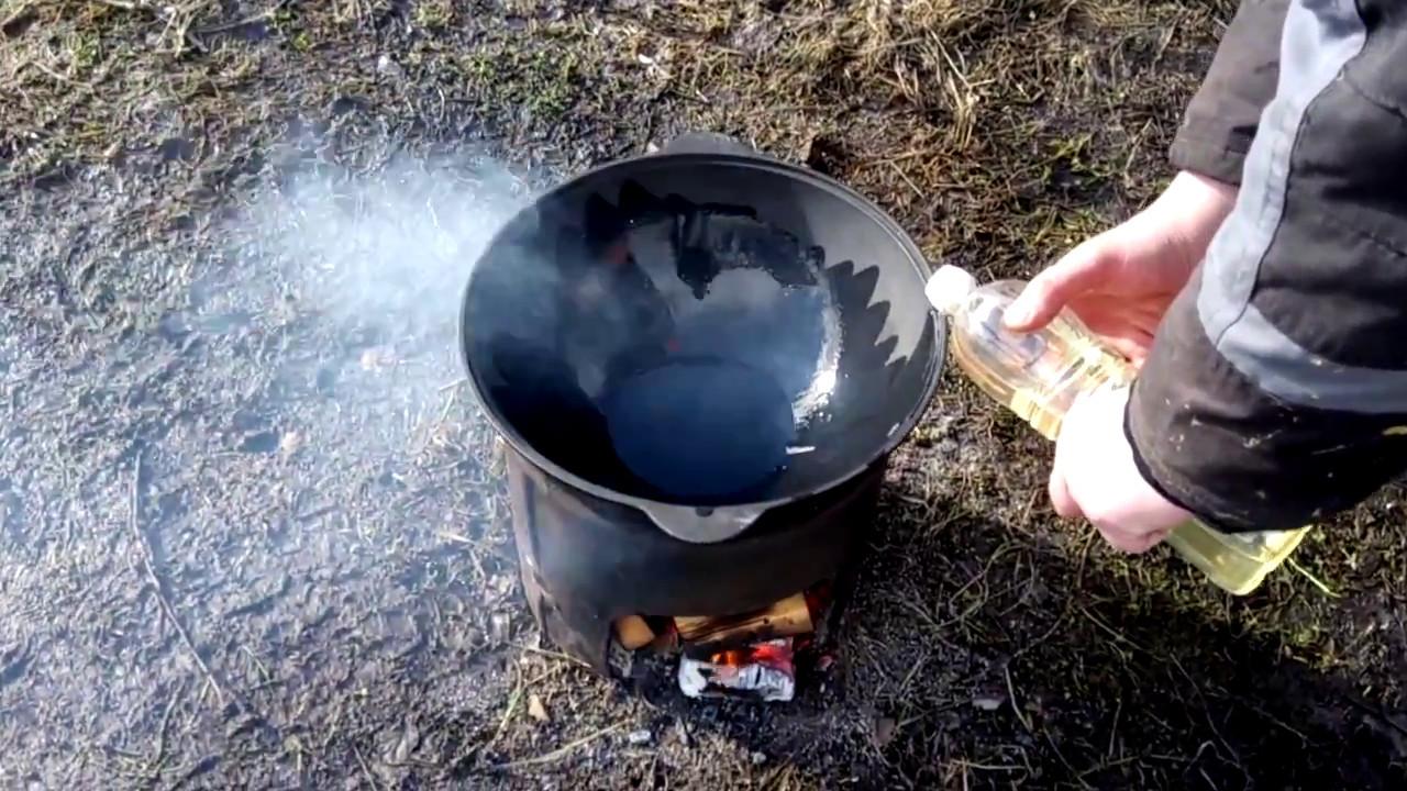 как прокалить казан маслом